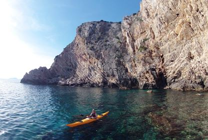 Kayaking along cliffs